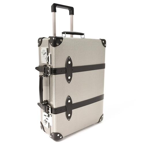 "Globe-Trotter goes Carbon Fiber this September to celebrate their 120th anniversary. The Carbon Collection is a limited edition run of 120 silver 20"" Trolley Cases made with Hypetex (the first coloured carbon fibre originally developed by F1 engineers.)"