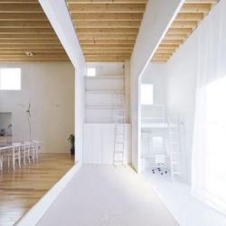 In Japan, the LAYERED HOUSE dispenses with walls in favor of stepped floors and narrowing apertures, creating a more nuanced division of space.