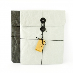 SIWA cushioned iPad case, with soft sheer fabric liner to keep your iPad scratch free, button and string opening ensures contents are safe and secure. Designed by Naoto Fukasawa,