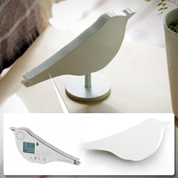 'Bird Alarm Clock' designed by &design. Made with resistant ABS plastic it can be used on a stand or on the wall. Available in light pink, light brown and light blue colors.