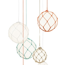 Lovely lights from TAFT ~ a mix between retro buoys and colorful macramé turned into hanging glass lamps
