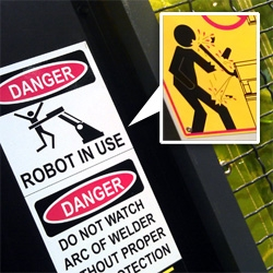 Ways Machines Can Hurt You! WESTEC (manufacturing show from the Society of Manufacturing Engineers) lead to a look at the many amazing WARNING graphics on heavy machinery. SO fun!