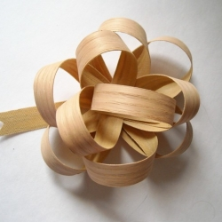 Superb veneer bows from artist Christine Tillman. Think of it as a bit of holiday cheer that can last all year without seeming cheesy.  Handmade and very affordable.