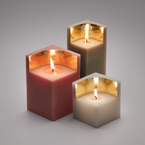 The Ontwerp Duo Auric Candles reflect the light of the candle with a wall of gold. 3 sizes to make a beautiful setting.