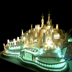 An intricate & exquisite paper castle by artist Wataru Itou.  The exhibition is called Umi no Ue no Oshiro (castle on the water).  It includes lights, a ferris wheel & a moving train!