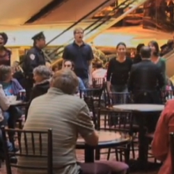 7 ImprovEverywhere agents staged a spontaneous musical during lunch at the Trump Tower atrium.