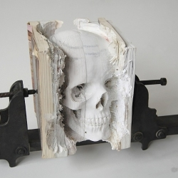 Three Degrees of Certainty II, an incredible piece in the Incarnate series. Human skull carved into old software manuals. artistic works using unusual media, by Maskull Lasserre.