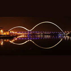 The glowing Infinity Bridge in Stockton-on-Tees, not only looks like the infinity symbol when reflected, but provides an interactive kinetic experience as you walk across it.