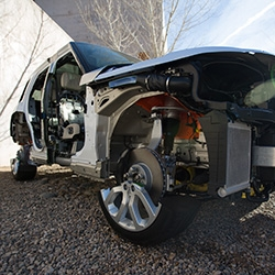 Looking under the skin of the Land Rover 2013 Range Rover - this cutaway shows the all the aluminum, the pillowy seat massager mechanisms, meridian sound system, the tires in half and more!