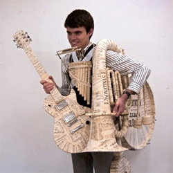 Luxury brand Hermès UK hires Kyle Bean to do their late 2009/early 2010 window displays. And what does he do? He covers a bunch of instruments in paper and plays a little tune (aesthetically)...!