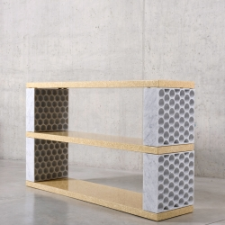 Inverso is a storage system studio Jens Praet for PlusDesign Gallery in Milano, composed by honeycomb patterned marble blocks and particle board shelves both produced with use of avant-garde production methods.