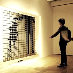 Iris by Hybe is an interactive media canvas made of an expandable LCD matrix. Using the Kinect, the installation begs users to play with it.