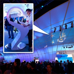 "Intel's interactive lifeform generator at CES: 168-foot-wide interactive 3D virtual life simulation where you can create a silhouette where it is used to create ""unique bioluminescent lifeform on the massive projection surface overhead."""