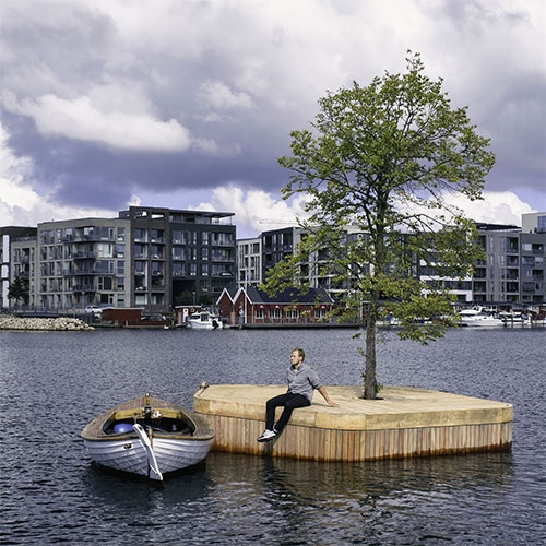 Copenhagen Islands by Fokstrot. CPH-Ø1 is a small 20m2 hand made wooden platform with a linden tree at its centre. The first in a series of moveable, floating, public spaces free for people to explore and conquer.