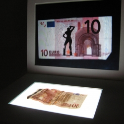 Cashback by Vincent Jacquier, part of the 'give me more' exhibition at DMY Berlin. A bill placed on the cashback glass reveals, a stripper who begins his/her provocative dance moves. The higher the note's value, the more 'content'.