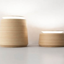 noon studio designed  this lathed wooden desk lamps with rotating lids which act as switches to control the light intensity.