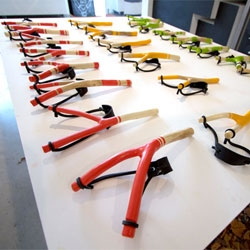 Chriopher Jarratt's 'Take a Shot' exhibition at the YCN shop and library on Rivington Street is filled with beautiful, colorful slingshots. They are both works of art as well as a means of making art when coupled with paintballs!