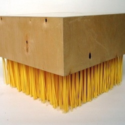 The bristles on this brush furniture by jason taylor look like raw pasta at first glance.
