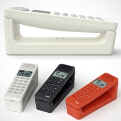 Jasper Morrison + Punkt: 'DP01' telephone. Its magnetic system allows it to sit in either horizontal or upright positions. The cordless DECT unit has a rubberized back that permits easy use of the handset's keyboard.