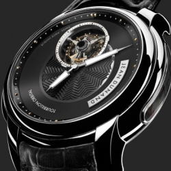 Jean Dunand's new tourbillon orbital, sheer elegance, and we love the mechanical empty/full gauge on the side to tell you how much energy there is left in the mainspring.