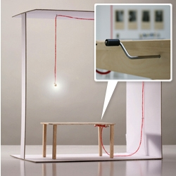 'Unexplectable' table + lamp by Jenna Postma. The LED lamp lights up when you lean on the table and a pulley system allows you adjust the lamp's height.