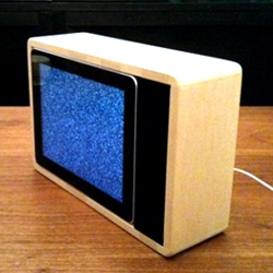 Jonas Damon built an iPad dock in the style of an old-school cathode-ray television and completed the '80s homage with a screensaver of grainy television snow.