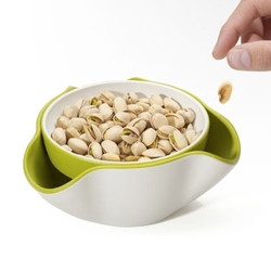 'Double Dish' by Joseph Joseph provides a fun  solution to the problem of serving snacks such as olives and pistachio nuts, with their inedible stones and shells, hiding any waste from view.