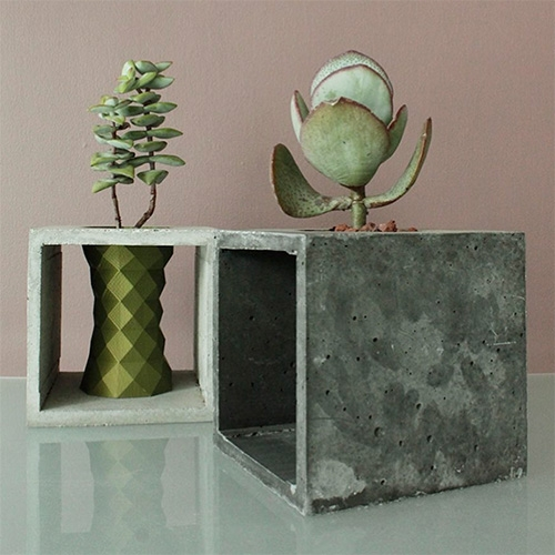 Juan Calavera Planters made of 3D prints combined with concrete frames.