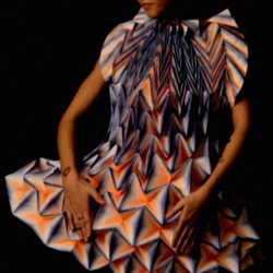 German designer Jule Waibel has created 25 of her folded paper dresses for fashion brand Bershka's shop windows around the world.