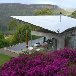 The Kangaroo Valley house, designed by Alexander Michael, is located two hours south of Sydney, Australia.