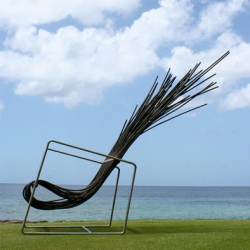 Flat packing tropical lounge chairs that make novel use  of wicker.
