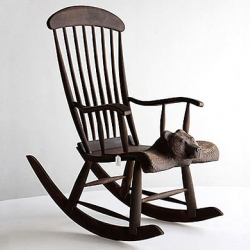 Karhupage Rocking Bear chair made with solid birch, burned surface. Design by Taito Huotarinen for Eimi, Finland.