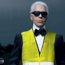 Karl Lagarfeld posing with a yellow vest in this new campaign by Lowe Strateus agency.