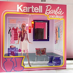 The windows of Kartell's Milan flagship store have been transformed for design week into six room settings, each animated by a life size Barbie.
