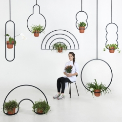 Katerina Kopytina, Moscow based designer specializing in product and industrial design, with Kuiper Belt Hanging Pots, dedicated to the life forms which have yet to be discovered.