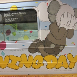 MTA Subway Times Square Shuttle cars adorn top to bottom with KAWS artwork. Inspired by Dr. Suess,  these cars are out to promote the introduction of the  Thanksgiving Day Parade KAWS Companion Balloon.