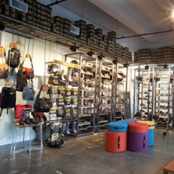The Keen Garage in Portland sells Keen Footwear. Great conservation project using re-used and recycled ceiling and metal fixtures.