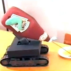 This automated ketchup squirting robot has its own theme music... Words do not begin to describe the strange awesomeness of this video.