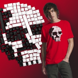 Classic skull design t-shirt made from Apple Mac white and original iMac black keyboards. Does it say something about the obsolescence and redundancy of computer equipment, or is just a cool tee?