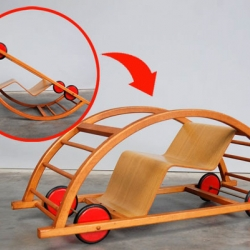 "Designed by Hans Brockhage and Erwin Andra in the 1950s, the ""Schaukelwagen"" can be flipped one way to use as a child-sized play car or tilted upside-down to become a rocking chair."