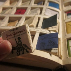 How would you explain a kindle to Charles Dickens? Rachel Walsh designed 40 miniature books and placed them inside of a Victorian version of a portable reader – a hardcover book.