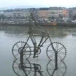 This is a kinetic sculpture of a biker in Budapest on the Danube river. The wheels are moved by the flow of the water. Or at least, they are supposed to be...
