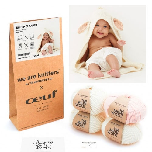 We Are Knitters x Oeuf collection of adorable knitting kits for baby sheep and bunny blankets, onesies, hats, and booties... but you have to knit it yourself! (Start now for holiday gifts?)