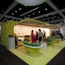 Kohler's booth at Dwell On Design is a great use of a shipping container that opens up... and colorful bath tubs cut to create couch/love seats to lounge in while charging your phone/etc!