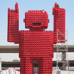 This huge 'fan man' made with 2,500 used Coke crates, stands 16.5 meter tall, located in Newtown Joburg at the fan park. By Crafetefan.