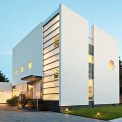 Kowalewski Residence by Belmont Freeman Architects is located in an established Nassau County beach community.