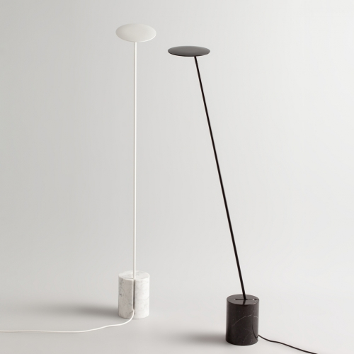 Circles designed by Kutarq Studio for Millelumen Germany. A minimalist reading floor lamp that combines a thin metal structure with a cylindrical marble base. The main body can be adjusted in three different positions.