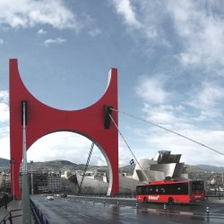 La Salve Bridge in Bilbao, Spain.  Originally designed by Juan Batanero in 1972, the bridge was recently updated with a red arch designed by French artist Daniel Buren.