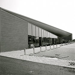 A commercial building in Fermo, Italy. The design by Spacelab Architects re thinks the traditional box by folding planes.