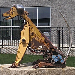 Doug Makemson's Dog Sculptures made of backhoe and bulldozer parts in the Atlanta Airport Dog Park. The one above is inspired by his yellow lab, Abby.